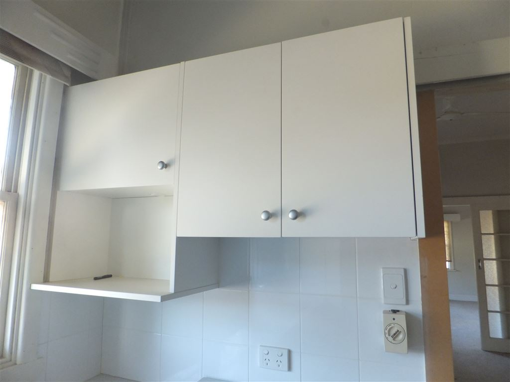 New kitchen cupboards & microwave shelf
