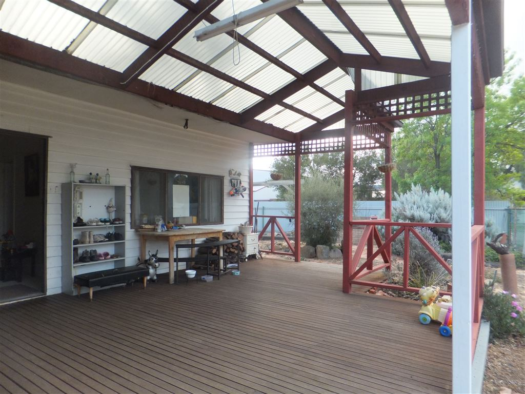 Expansive decking area, fully covered with sliding doors accessing dining room & kitchen areas of house