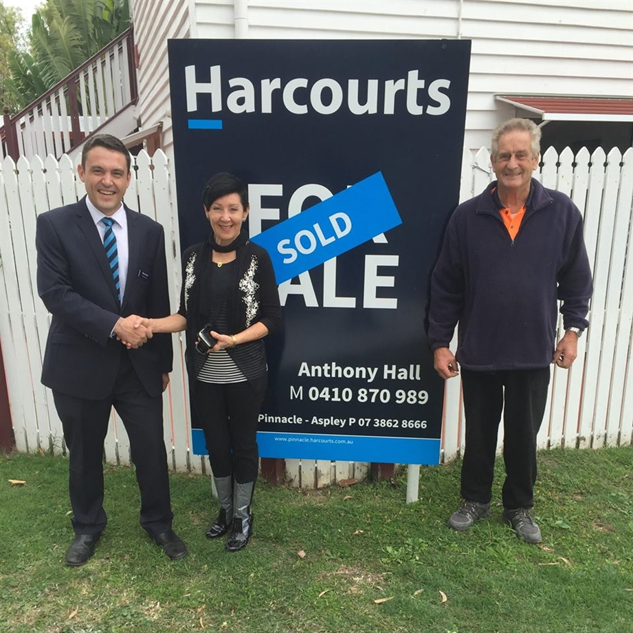 Sold sign Anthony Hall