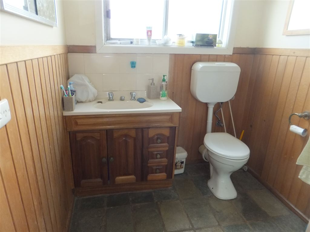 Second bathroom with shower, toilet, vanity & fully tiled floor