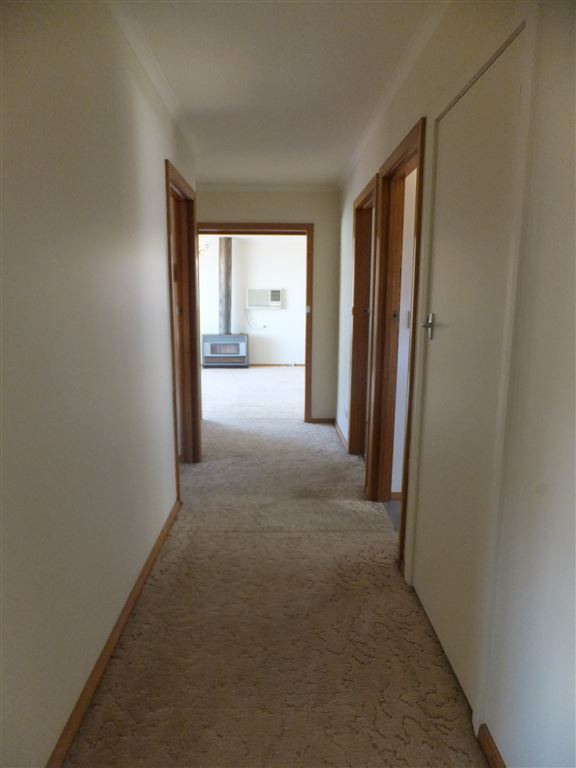 Central hallway; view from main bedroom & bathroom towards lounge