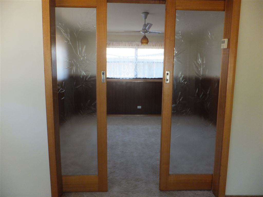Sliding glass doors into second lounge
