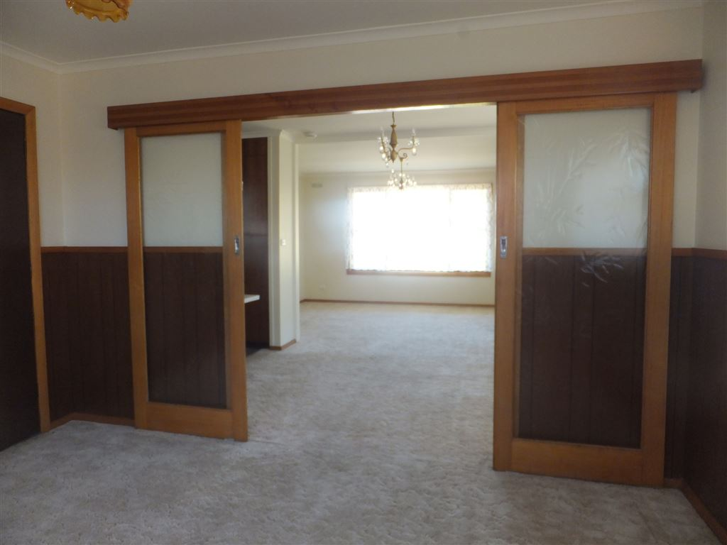 Second lounge looking toward main lounge, door on left of photo leads directly to outside patio
