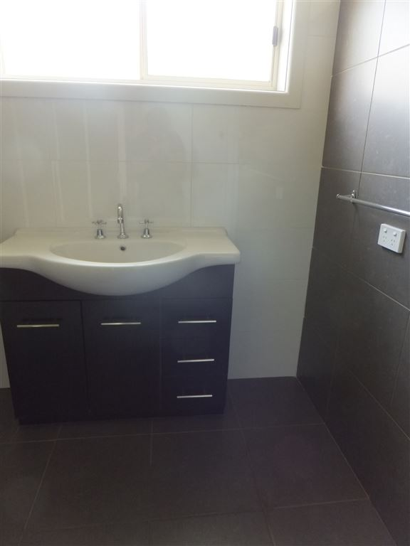 Completely new bathroom with new vanity & all new tiling
