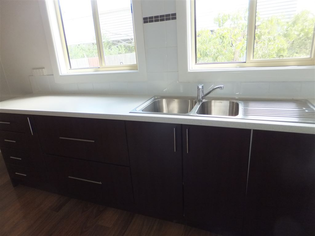 Double sink with mixer tap & lots of cupboard storage