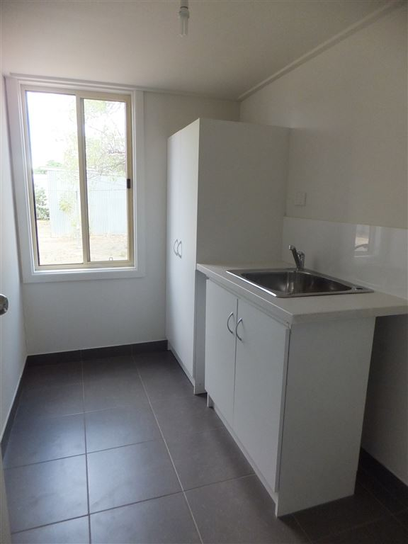 All new laundry with fully tiled floor and extra cupboard for storage