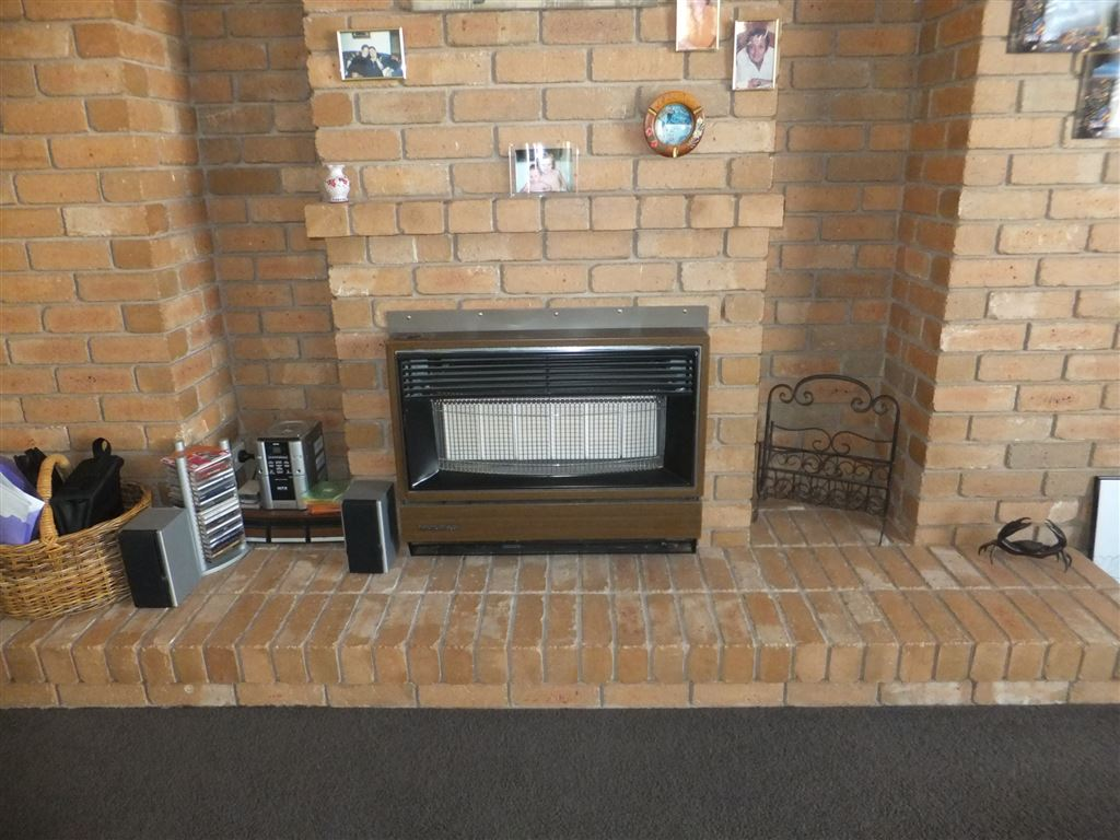Gas heater in main lounge, bricked feature wall has been set up to allow a wood heater to be built-in with wood storage niches built-in to the walls(these could have shelving built-in if required)