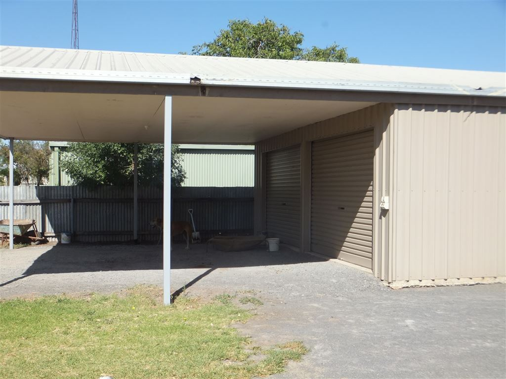 Undercover carport at end of double garage