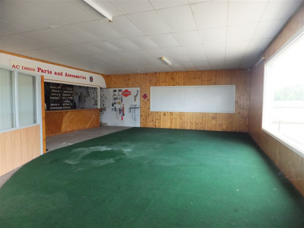 Showroom floor, spare parts counter & office