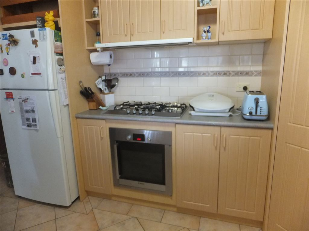 Large kitchen with gas cook top, electric oven, large pantry, dishwasher, wine racks & breakfast bar