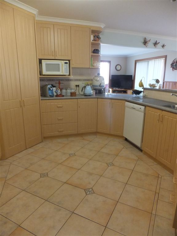 Kitchen showing quality tiled floor