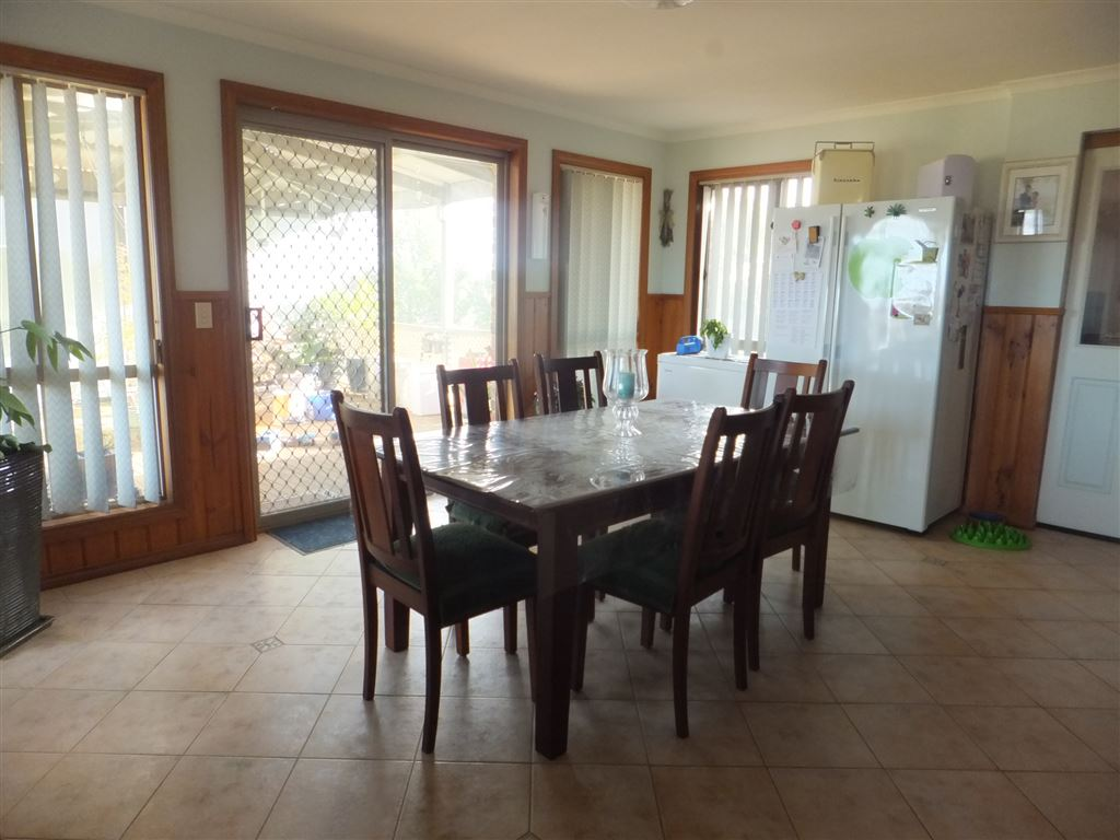 Huge dining room with quality tiled floor. Sliding doors open out onto weatherproof rear decking/enntertaining  area