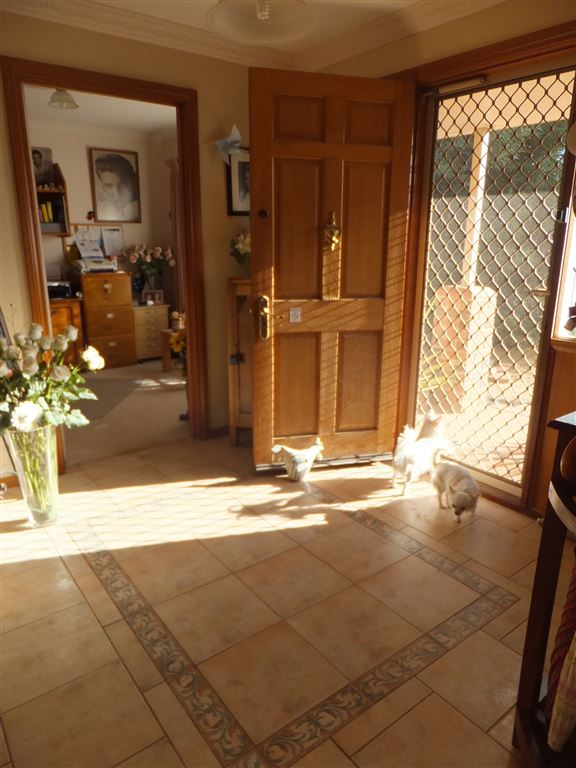Front entrance to property(quality tiled floor & security doors) with office at rear of photo