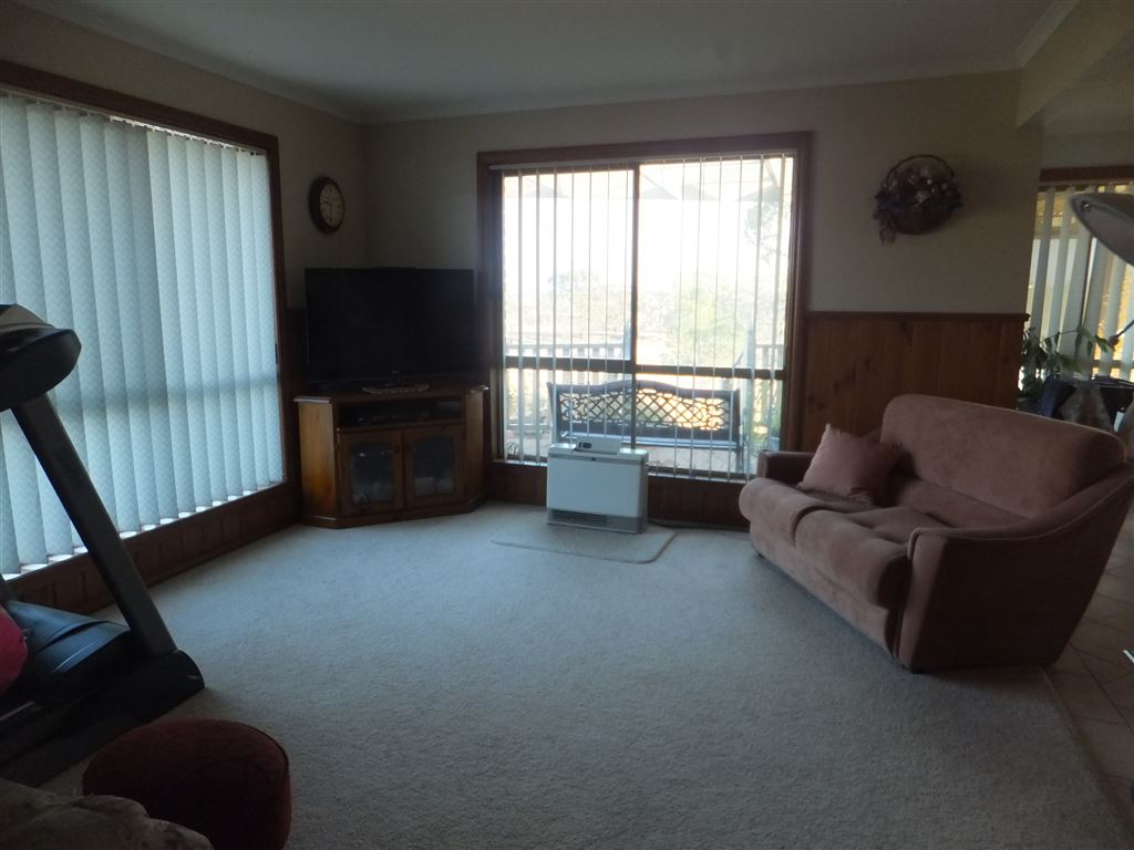 Large lounge with gas heating(Elgas Contract)& floor to ceiling windows looking over yard
