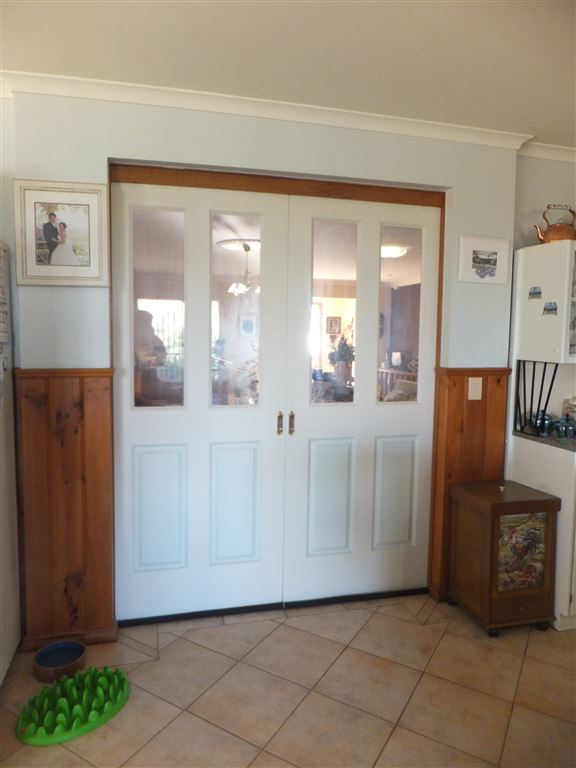 Doors leading through from dining kitchen area through to large front lounge/rumpus room