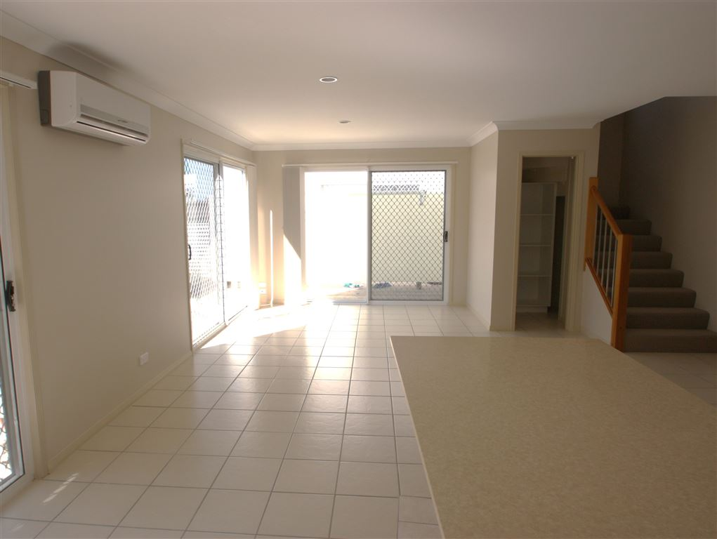 Harcourts Coomera - living area