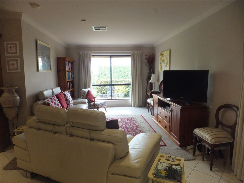 Family & living area with large window at rear overlooking patio & stunning garden