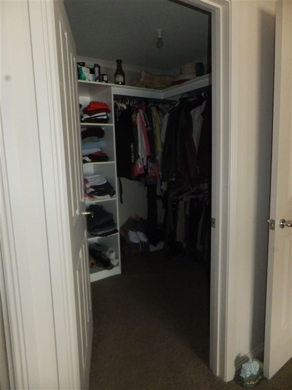 Large walk-in robe in main bedroom with shelving & hanging space