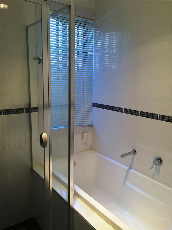 main bathroom - sep bath and separate shower alcove/ glass screen & door.