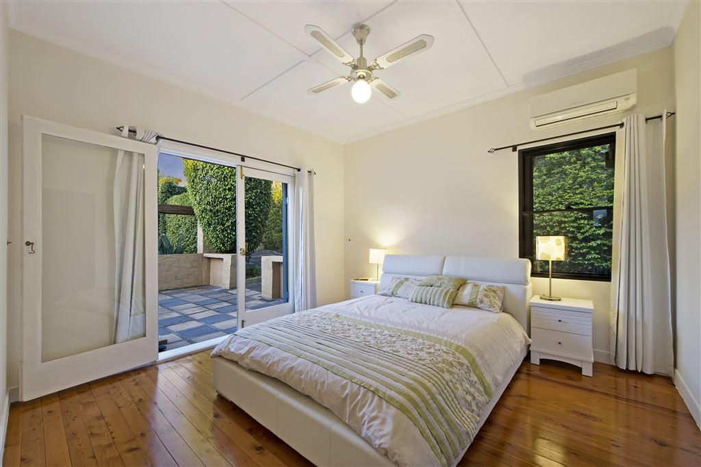 Bedroom One - Aircon - Ceiling Fan - Builtin Robe