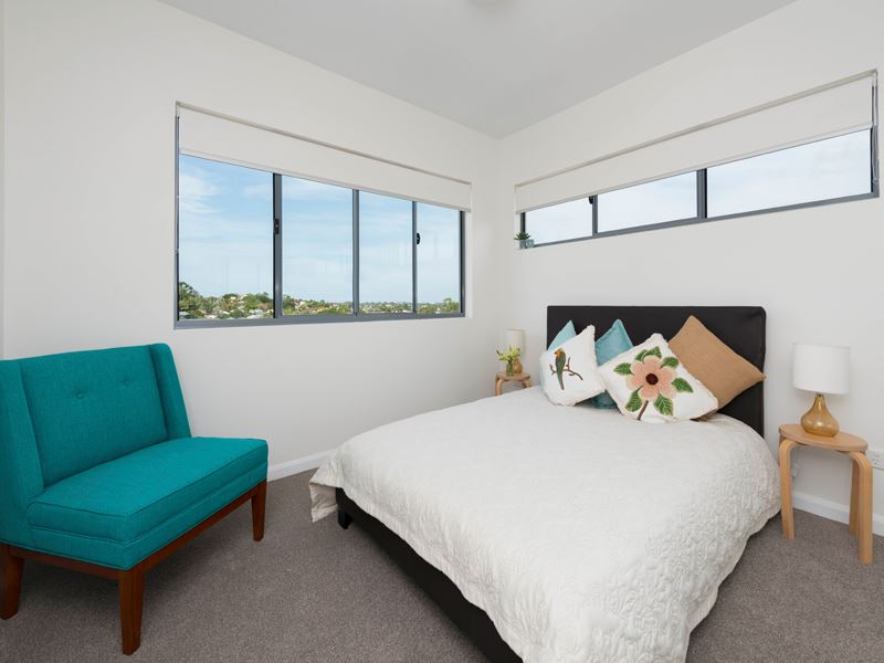 Unit 21 - Level 5 - Main bedroom with ensuite bathroom and builtin robes