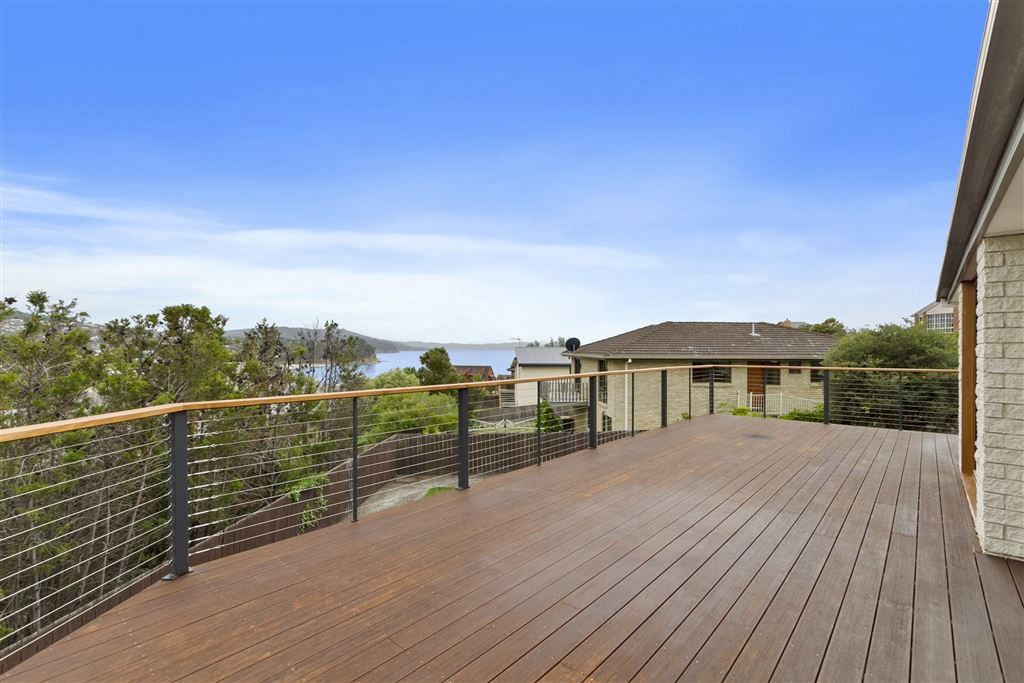 Expansive family home with great water and beach views