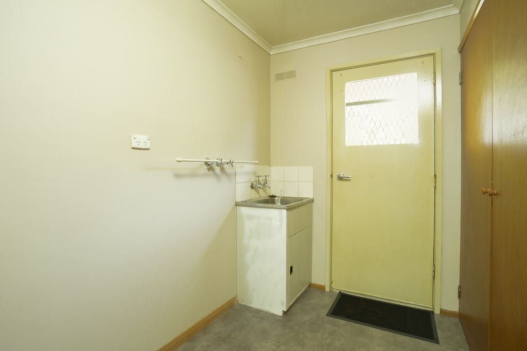 Laundry with large Linen Cupboard