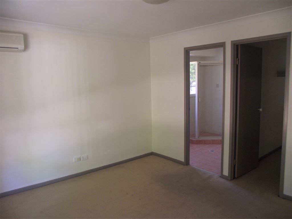 Air conditioned master bedroom with ensuite and walk in robe