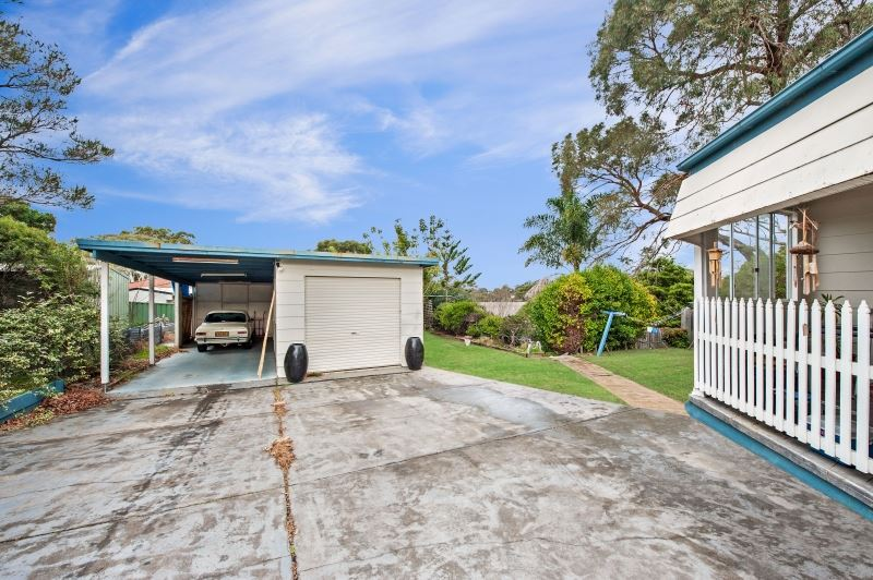 Rear of Property with Garage and Open Carport