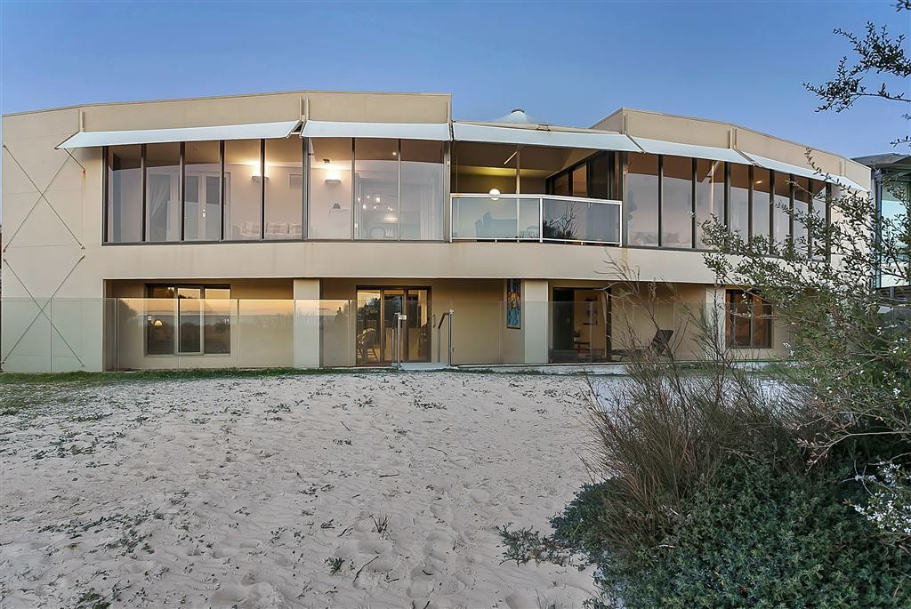 Absolute beachfront home with ocean views & gorgeous sunsets