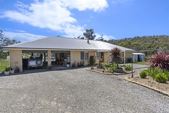 Modern Home & Plenty of Sheds on Approx 8 Ac.