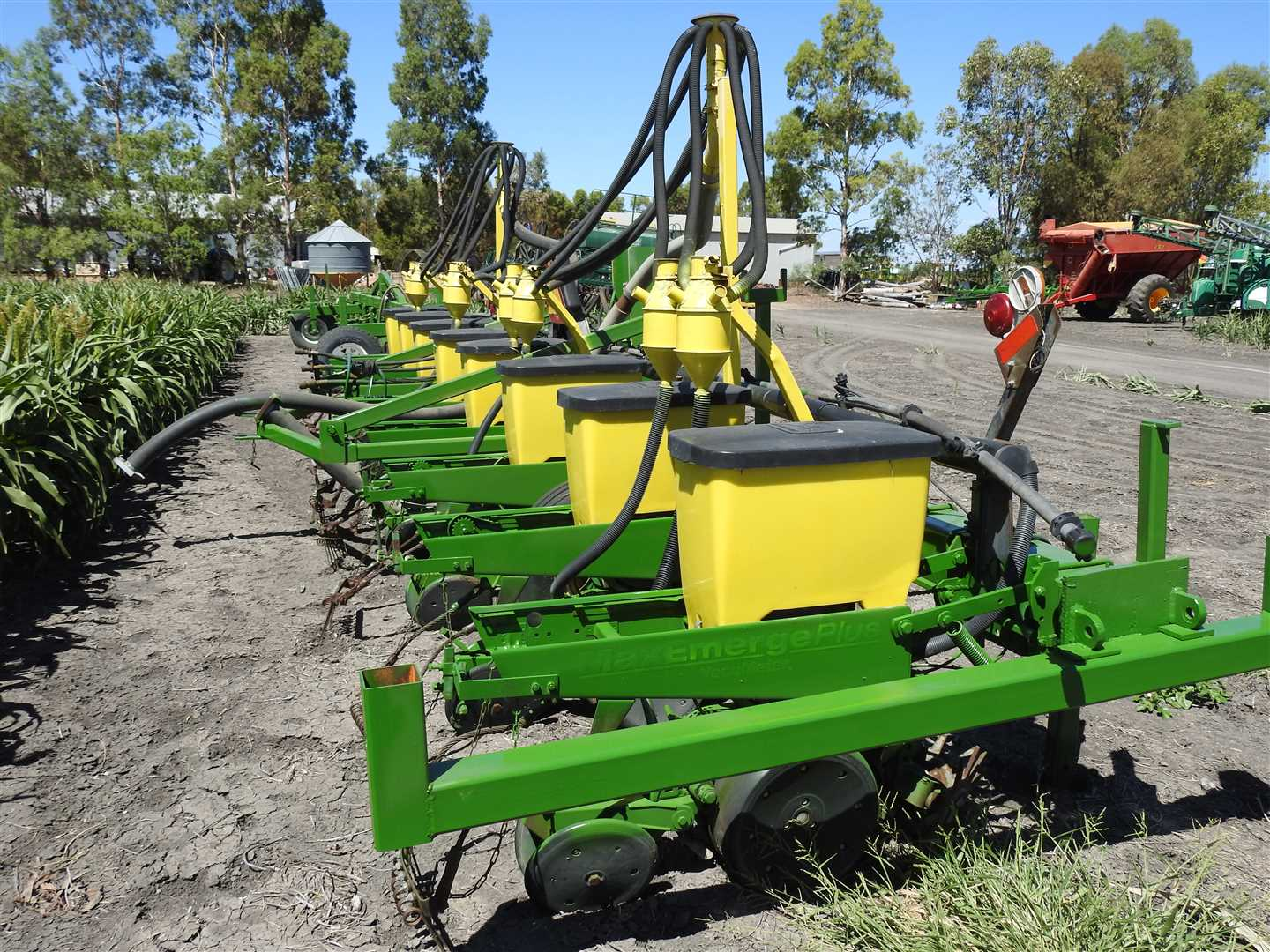 JD Maximerge 8 M planter, with liquid injection, 8 row trashwhippers and solid fertiliser tubes.