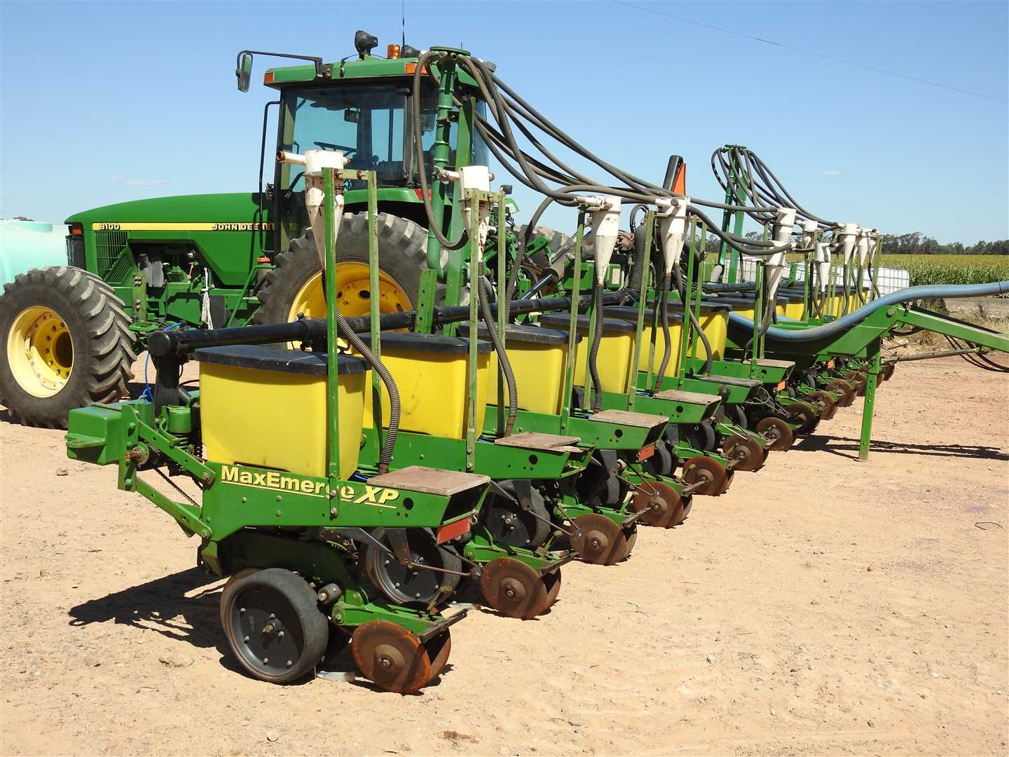 12m, 13 JD Maxi=merge planter units tpl, with air seeder attachments - trashworkers, steel press wheels.