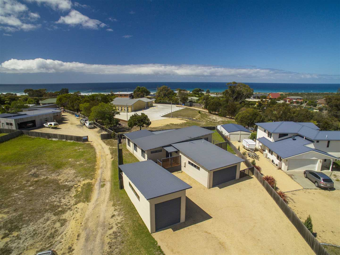 Beautiful home with garaging and 10m2 x 4m2 boat shed.