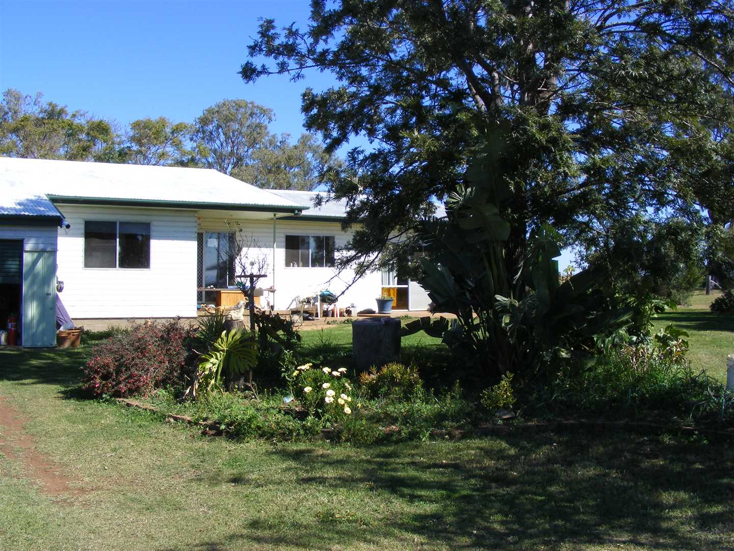 Three bedroom timber home, established lawn and garden surrounds.  Water from tanks and garden water from equipped bore.