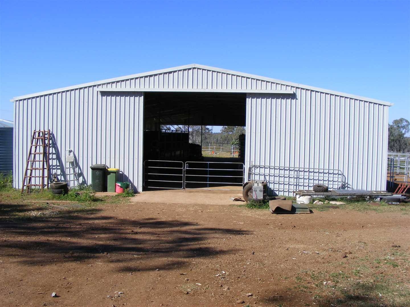 Machinery shed-concrete floor, power