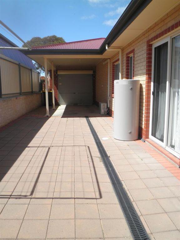 Secure Carport with Roller Door