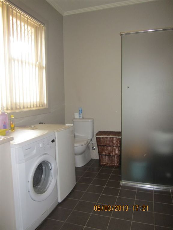 Laundry with 2nd Shower & Toilet