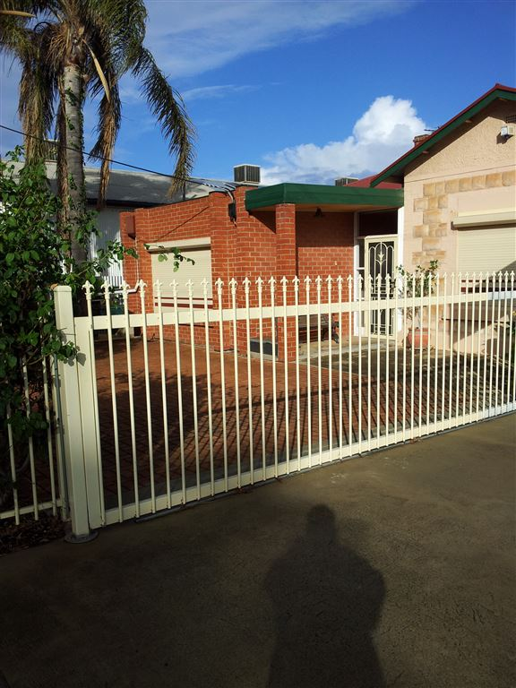 Front parking area with security gate