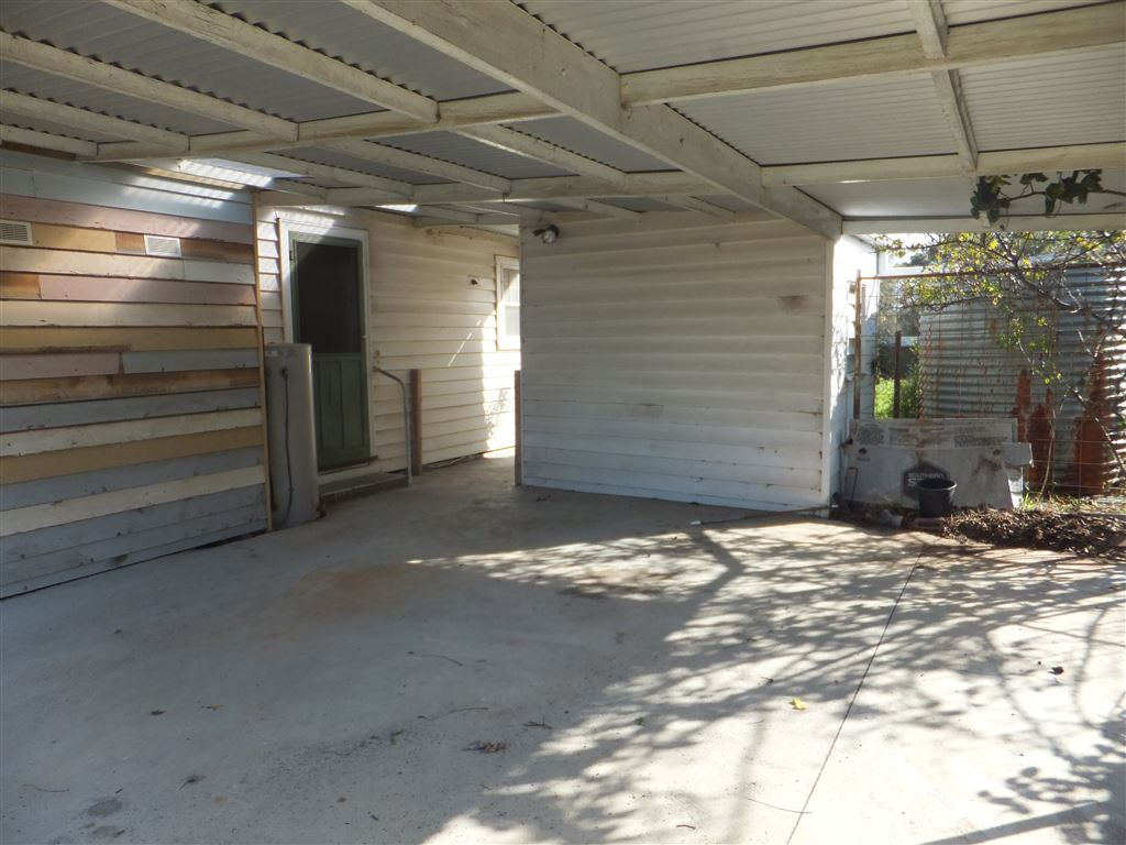 Double carport with concreted floor & undercover side entrance into house