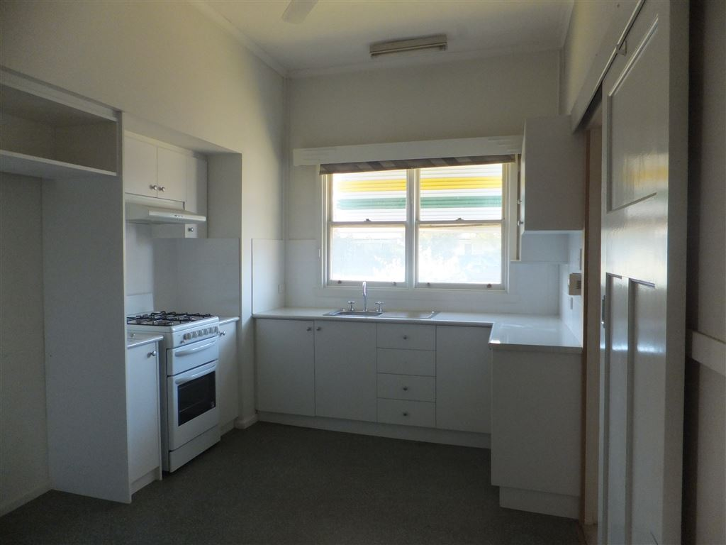 New kitchen with gas stove, fridge & microwave recesses, cupboard storage galore & window overlooking front yard
