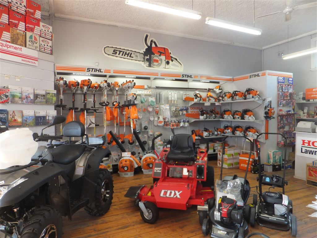 Shop floor showing mowers, ride-on mowers and Stihl garden equipment