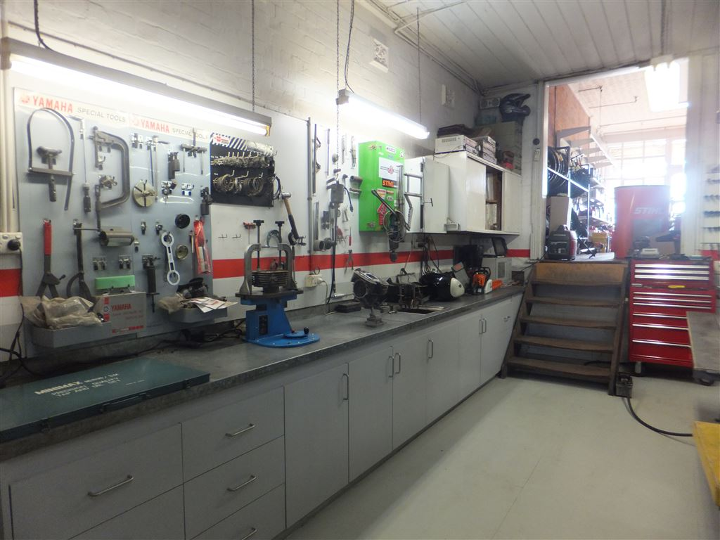 Service workshop looking up to second showroom floor. All benches, tools & extensive equipment are included with sale