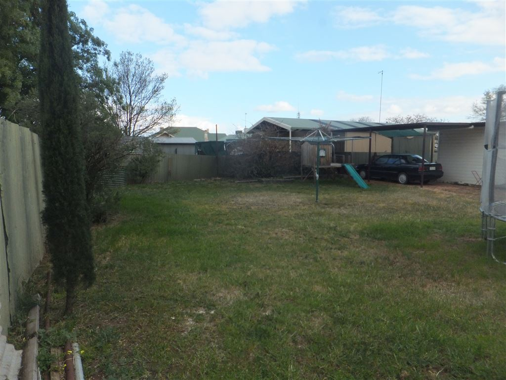 Large rear yard with plenty of room for kids playground, trampoline & vehicles