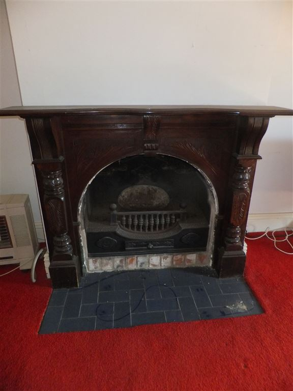 Original fireplace in dining/family room; this room also has bayonets fitted for gas heating