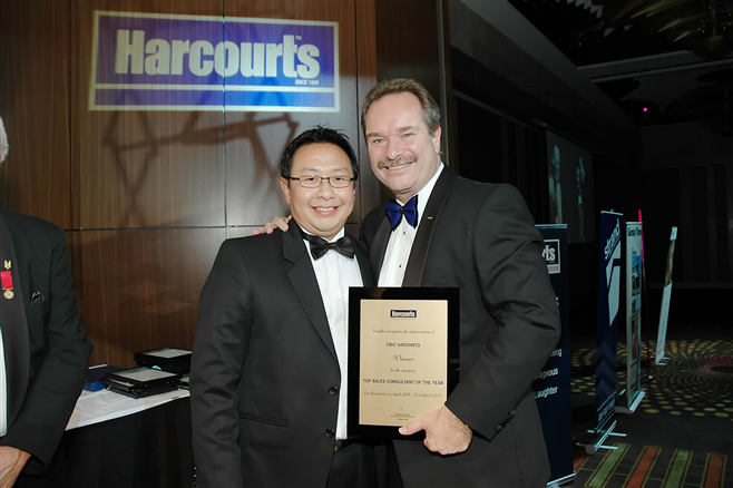 Eric Hartanto with Mike Green, Managing Director Harcourts International