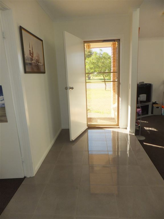 Entrance foyer; all external doors are fitted with quality security doors and all floor tiles are in perfect condition