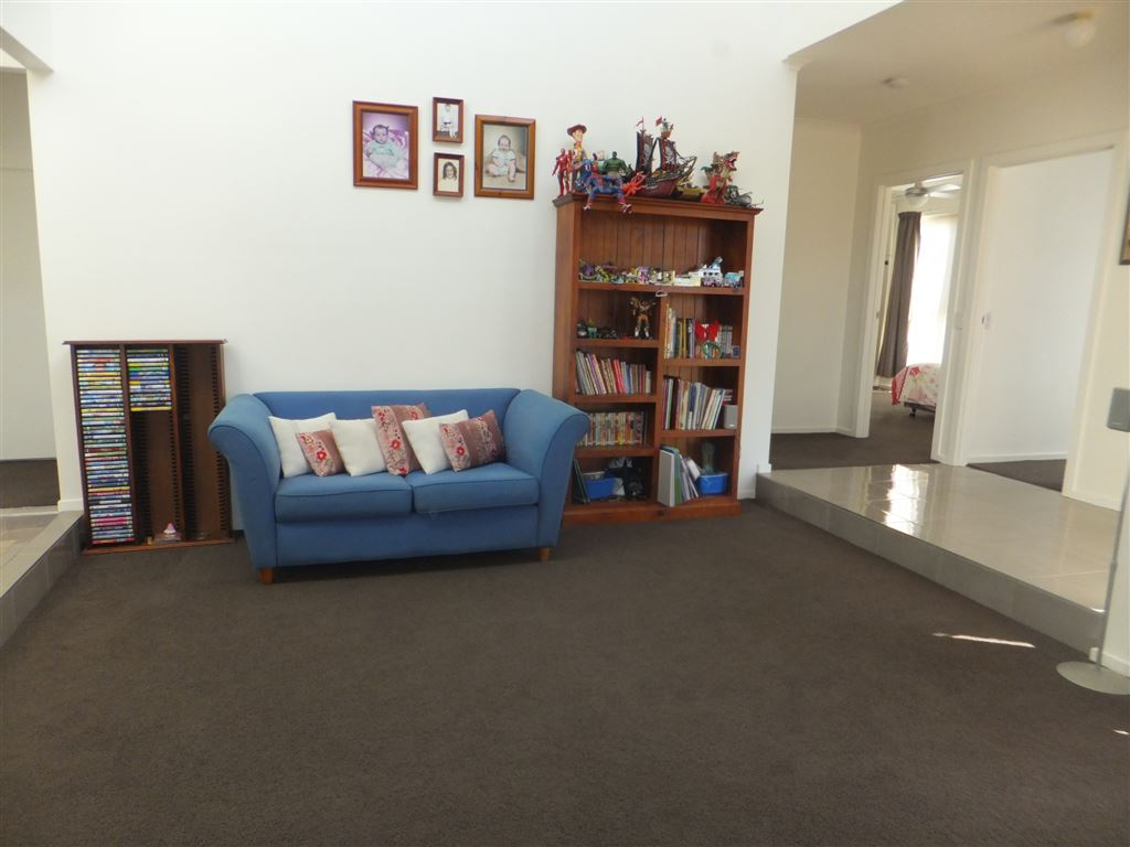 Informal lounge room, close to house entry foyer with vaulted ceilings and an abundance of natural light