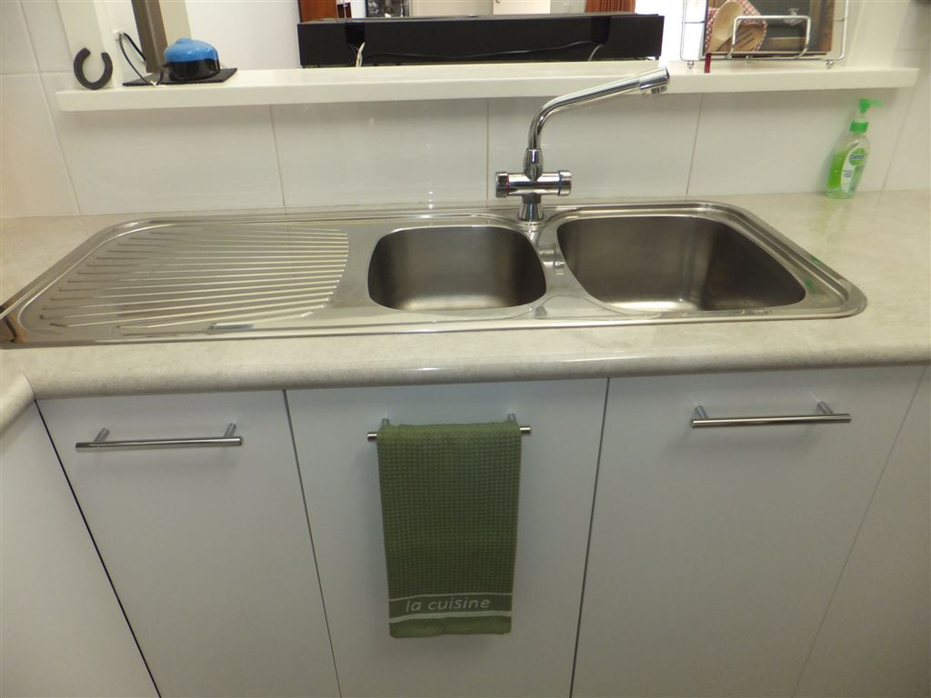 Double sink with under bench electrical fitted for a dishwasher if desired