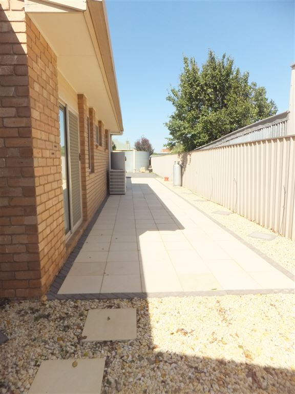 Fully paved entertainment area/service area at rear of home: width 4m x length 15m. Sliding glass doors shown closest to edge of house are doors which lead out of Master Bedroom